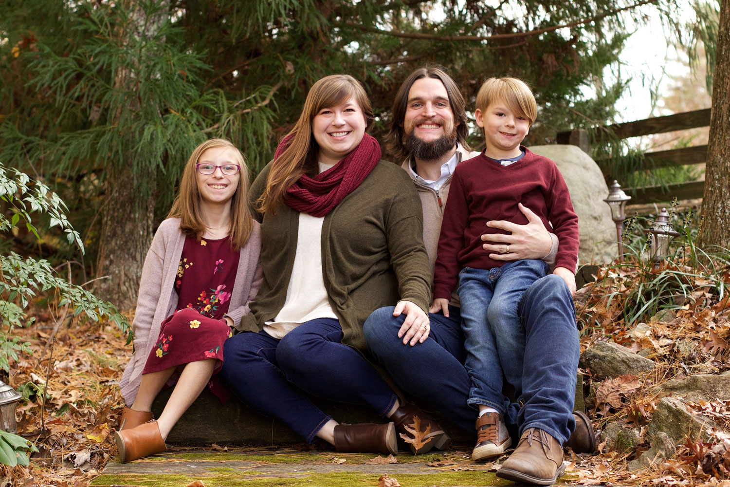 Photo of Erik, his wife, and two kids sitting outside